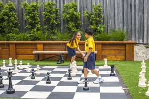 students playing chess at multipurpose courts